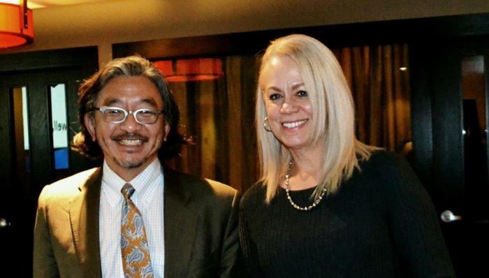 A picture of Department of Transportation Director Harold Taniguchi and former Deputy Director Laurie Brown.