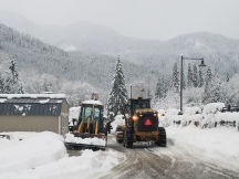 King County Roads crews helped plow a school parking lot in snow-covered Skykomish so crews could deliver a generator to a local K-12 school building.