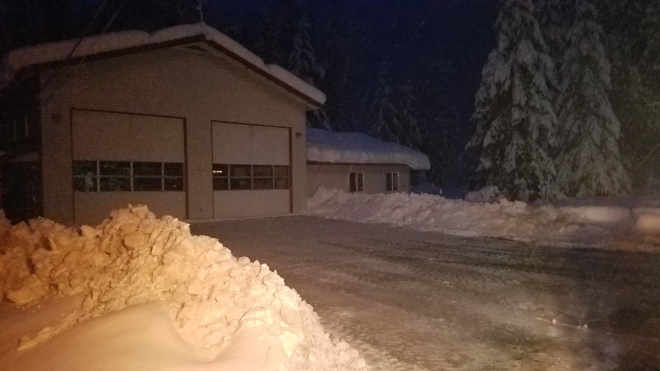 Using graders, King County Roads crews plowed the upper and lower Baring Fire station parking lots so the fire station could operate as an emergency shelter during the days-long power outage in Skykomish.