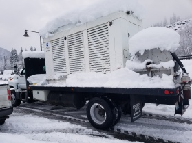 After King County Roads cleared a school parking lot, crews were able to deliver this generator to a school building in snow-covered Skykomish.